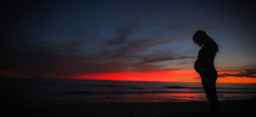 pregnant-beach-sunset-mother-51386-large
